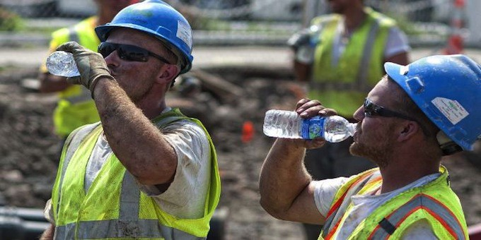 Construction Workers Drinking Water